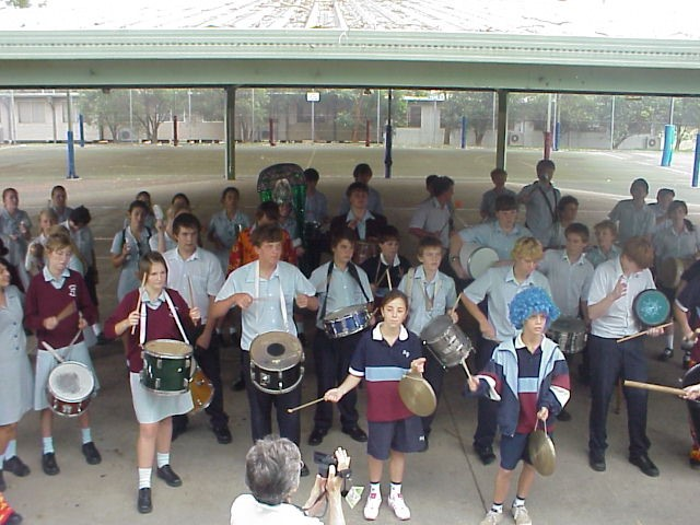 Group photo of you children in a drumming activity